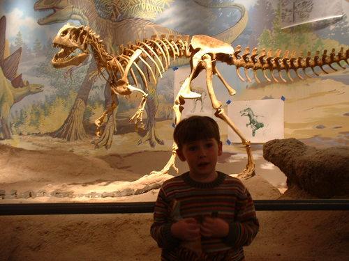 Liam and an Allosaurus skeleton